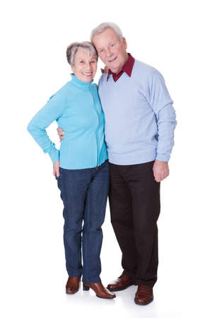 Portrait Of Happy Senior Couple Isolated Over White Background photo