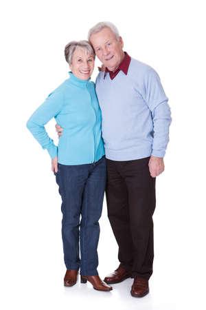retired couple: Portrait Of Happy Senior Couple Isolated Over White Background