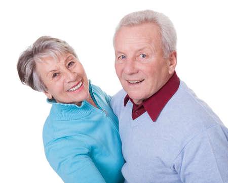 position d amour: Portrait Of Dancing Couple Senior Sur Fond Blanc