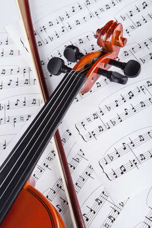 Close-up Photo Of Violin And Musical Notes photo