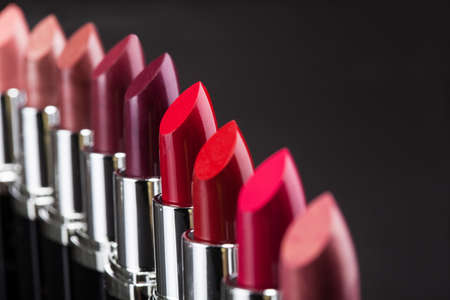 Lipsticks In A Row Isolated Over Gray Background Stock Photo
