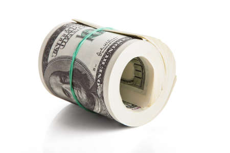 Rolled Us Dollar Notes Over White Background photo