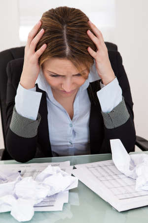 workaholic: Portrait Of Frustrated Businesswoman In The Office Stock Photo