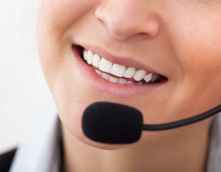 Portrait Of Happy Young Female Operator With Headphones photo