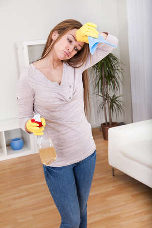 Portrait Of Young Woman Doing Household Chores photo