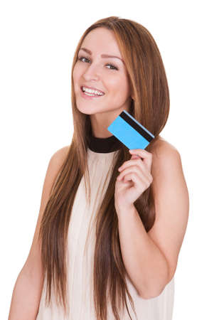 Young Woman Holding Credit Card Over White Background photo