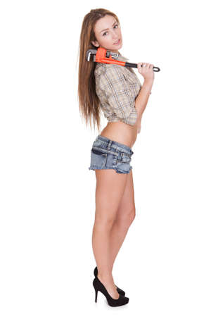 Young Attractive Female Plumber Isolated Over White Background photo
