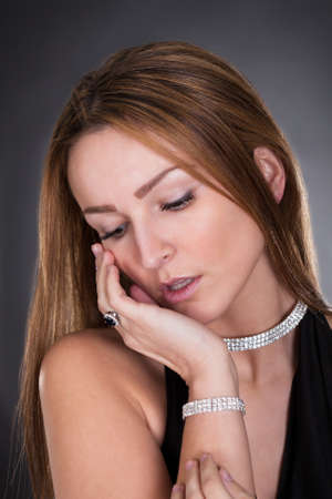 diamond necklace: Portrait Of Young Beautiful Woman Isolated Over Colored Background