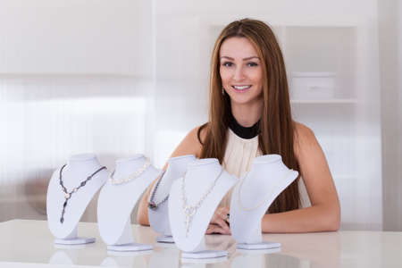 seller: Young Beautiful Woman Working In Jewelry Shop Stock Photo