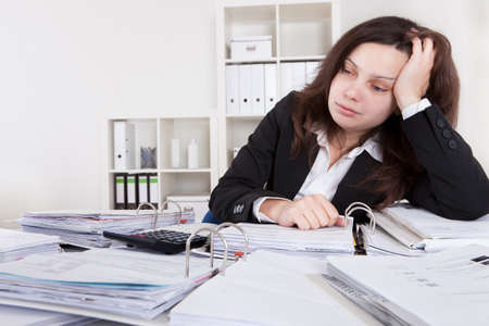 workaholic: Businesswoman Shocked From Financial Documents In The Office Stock Photo