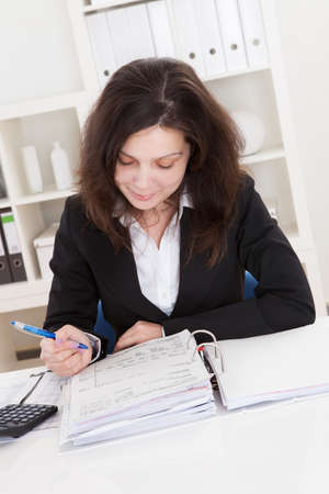 folder with documents:  Accountant Woman Working In Office