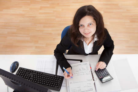 Photo Of Accountant Woman Working In Office photo