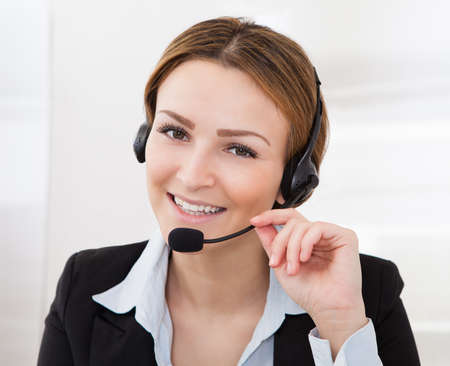 computer operator: Portrait Of Happy Young Female Operator With Headphones