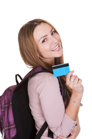 Female Student Holding Credit Card Over White Background photo