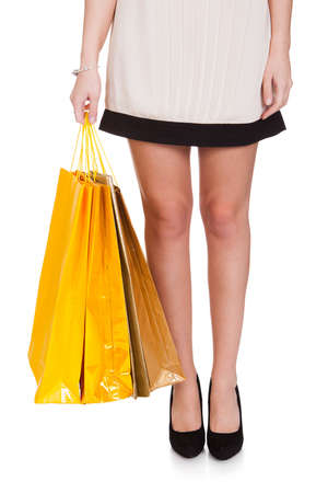 Woman Holding Shopping Bags Over White Background Stock Photo - 19003874