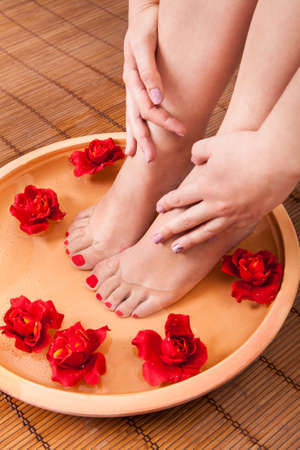 Close-up Of Female Feet Getting Spa Aroma Therapy photo