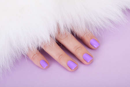carpet: Close-up Of Beautiful Fingers Below Fur Isolated Over Purple Background