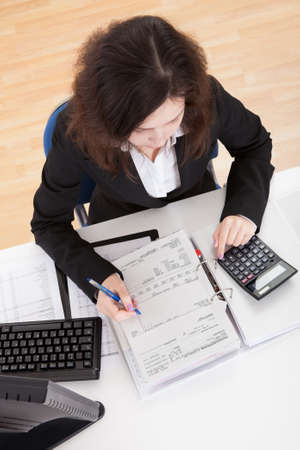 top angle: Photo Of Accountant Woman Working In Office Stock Photo