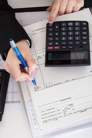 Close-up Of Accountant Woman Working In Office photo