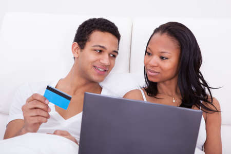 Portrait Of Young African Couple Shopping Online Stock Photo - 19168072