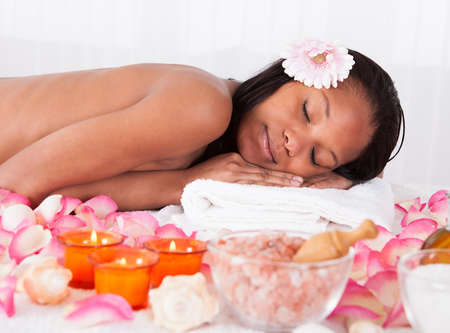 african american spa: Portrait Of Beautiful Young Woman Relaxing In Spa Stock Photo