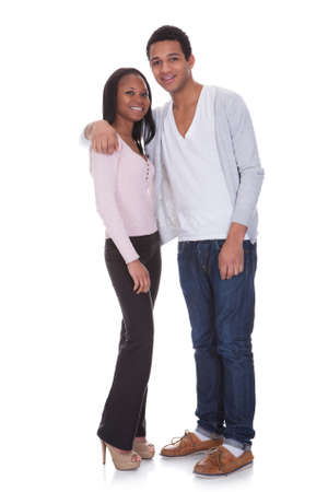 Portrait Of Young Couple Happy Isolated Over White Background Stock Photo - 19168032