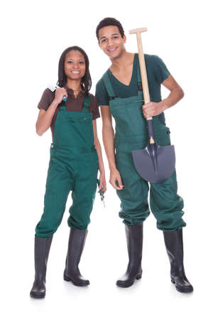 young farmer: Couple Of Garden Workers Isolated Over A White Background