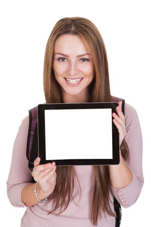 blank tablet: Female Student Holding Digital Tablet Over White Background Stock Photo