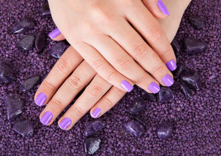 Human Fingers With Beautiful Manicure In Purple Color