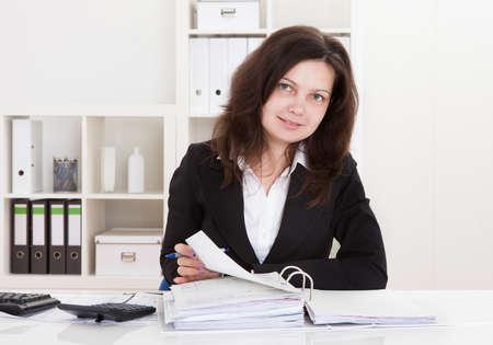 Portrait Of Happy Businesswoman Working In Office photo