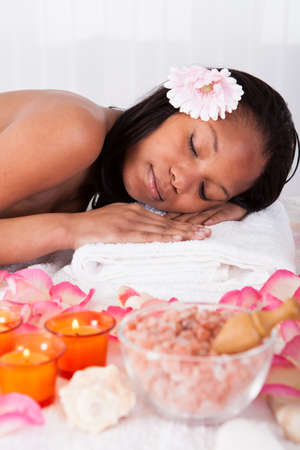 body massage: Portrait Of Beautiful Young Woman Relaxing In Spa Stock Photo