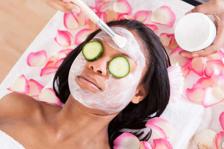 african american spa: Close-up Of Woman Applying Facial Mask In Spa Stock Photo