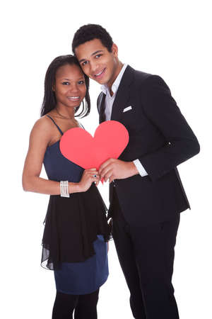 Portrait Of African Couple Holding Heart Over White Background Stock Photo - 19341035