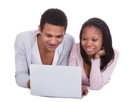 Young Couple Working On  Laptop Over White Background Stock Photo - 19341049