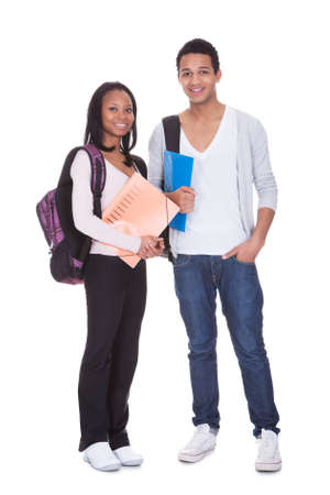 Two Students With Folder And Backpack Isolated Over White Background Stock Photo - 19341044