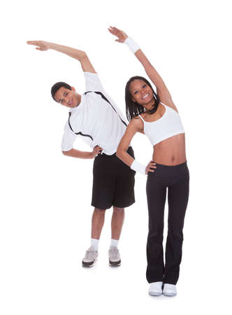 Portrait Of Young Couple Exercising Over White Background Stock Photo - 19341026