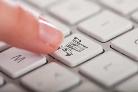 Close-up Photo Of Hands Pressing Buy Button Keyboard photo