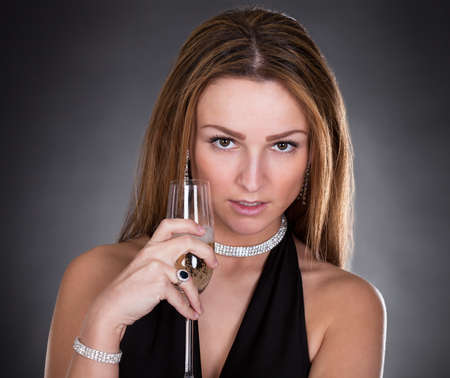 Portrait Of Young Beautiful Woman Drinking Champagne photo