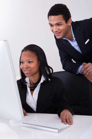 employee training: Portrait Of Happy Business People Sitting At The Desk
