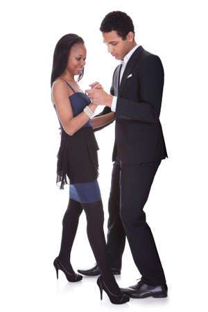 Portrait Of African Couple Dancing Salsa Over White Background photo