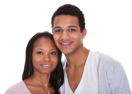 Portrait Of Young Couple Happy Isolated Over White Background Stock Photo - 19400050