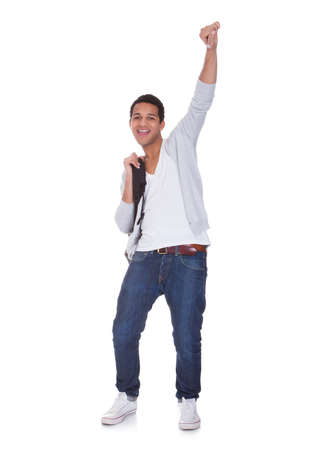 arms raised: Excited Student Man Isolated Over White Background