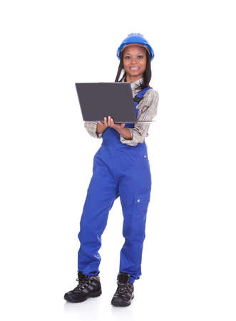 Portrait Of Female Worker With Laptop. Isolated On White photo