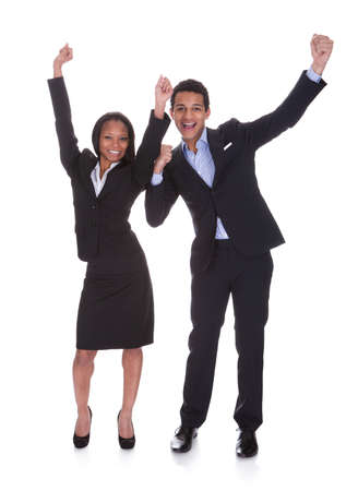 Portrait Cheering Young Business Couple Over White Background photo