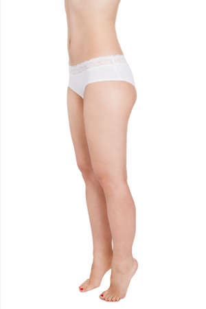 Close-up Of Female Wearing White Panty Over White Background photo