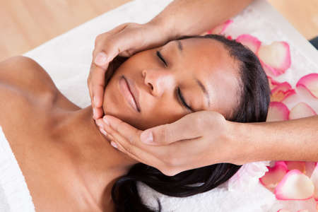 african american spa: Portrait Of Woman Having A Massage In Spa