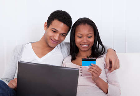 Portrait Of Young African Couple Shopping Online photo