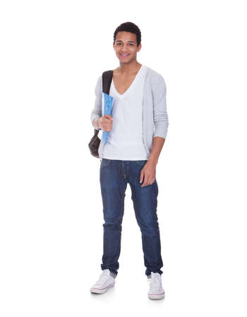 High school student: Portrait Of Student Man Isolated Over White Background Stock Photo