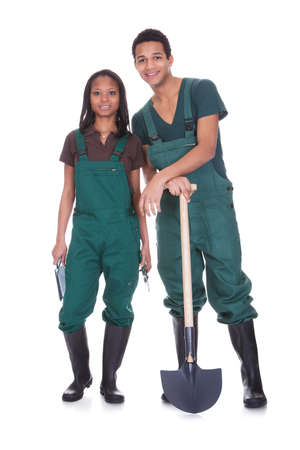 Couple Of Garden Workers Isolated Over A White Background photo