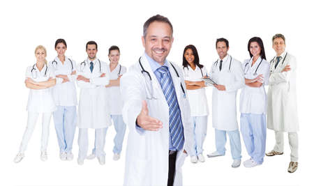 Large group of doctors and nurses. Isolated on white photo
